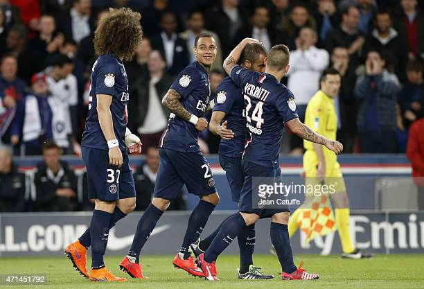 Gregory Van Der Wiel of PSG celebrates his goal with teammates during the French Ligue 1 match between Paris SaintGermain and FC Metz at Parc des...