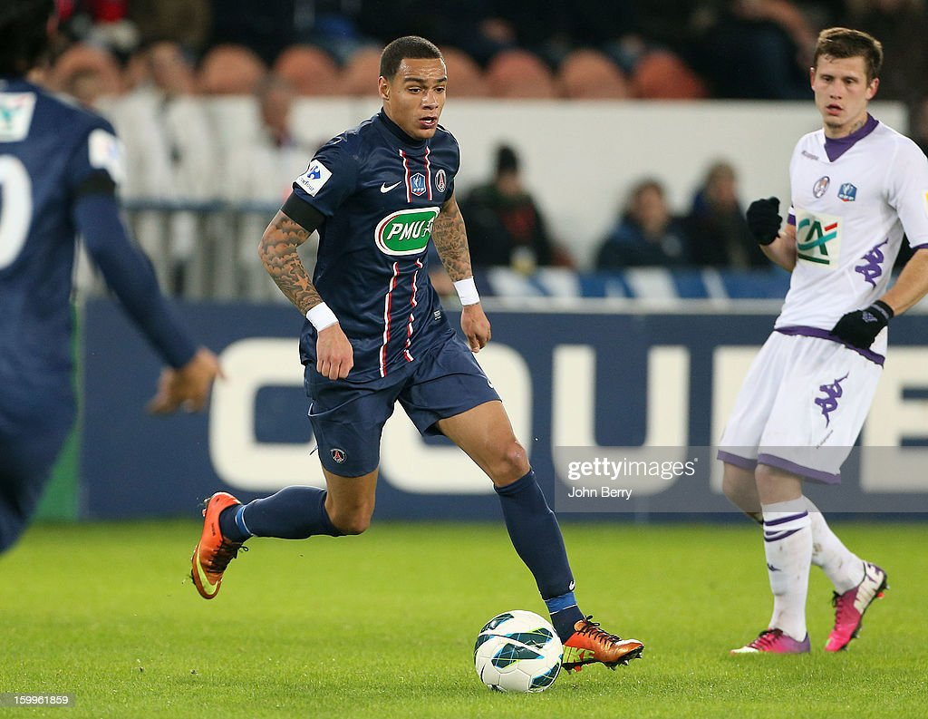 Gregory Van Der Wiel of PSG (C) in action during the French Cup match between Paris Saint Germain FC and Toulouse FC at the Parc des Princes stadium on January 23, 2013 in Paris, France.