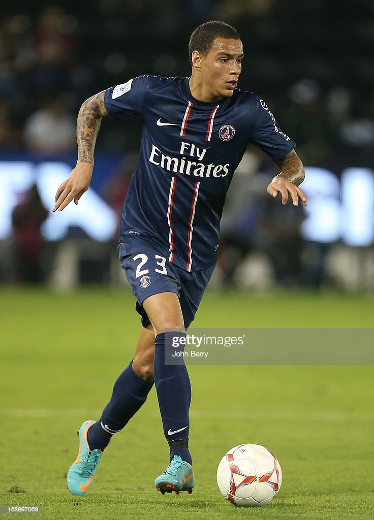 Gregory Van Der Wiel of PSG in action during the friendly match between Paris Saint-Germain FC and Lekhwiya Sports Club at the Al-Sadd Sports Club stadium on January 2, 2013 in Doha, Qatar.