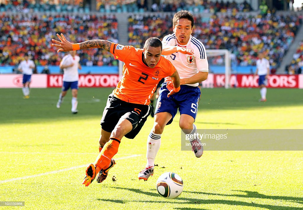 Gregory Van Der Wiel of the Netherlands is challenged by <a gi-track='captionPersonalityLinkClicked' href=/galleries/search?phrase=Yuto+Nagatomo&family=editorial&specificpeople=4320811 ng-click='$event.stopPropagation()'>Yuto Nagatomo</a> of Japan during the 2010 FIFA World Cup South Africa Group E match between Netherlands and Japan at Durban Stadium on June 19, 2010 in Durban, South Africa.