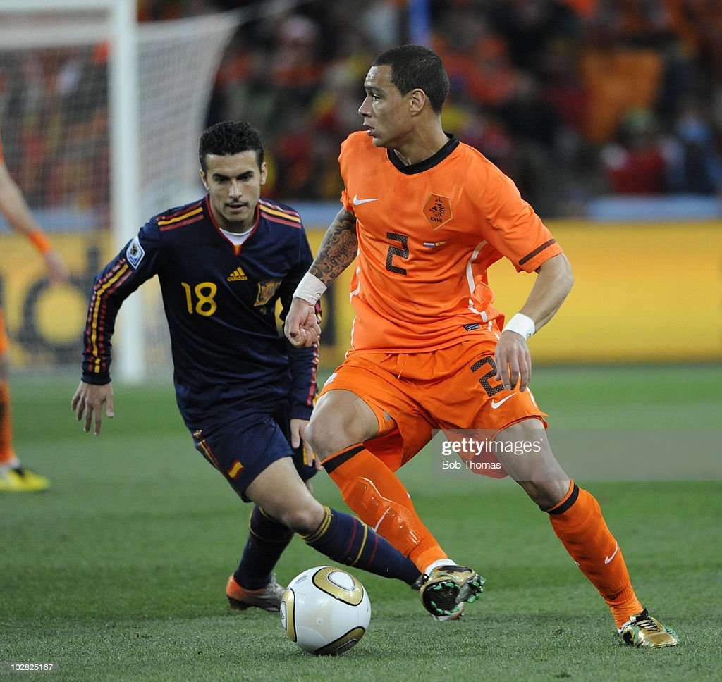 Gregory Van Der Wiel of the Netherlands watched by Pedro of Spain during the 2010 FIFA World Cup Final between the Netherlands and Spain on July 11, 2010 in Johannesburg, South Africa. Spain won the match 1-0.