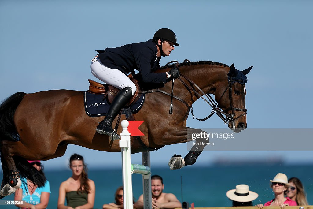 Gregory Wathelet jumps his horse over a hurdle during the Longines Global Champions Tour stop in Miami Beach on April 3 2015 in Miami Beach Florida...