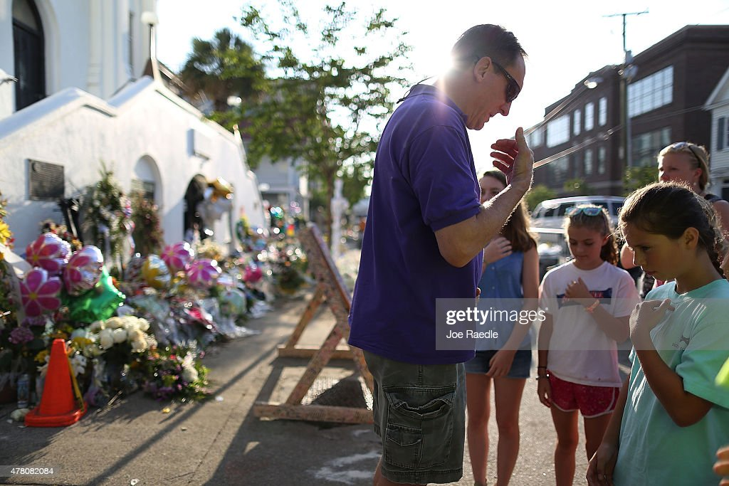 Gregory West leads a prayer in front of the Emanuel African Methodist Episcopal Church after a mass shooting at the church killed nine people, on June 22, 2015. 21-year-old Dylann Roof is suspected of killing nine people during a prayer meeting in the church in Charleston, which is one of the nation's oldest black churches.