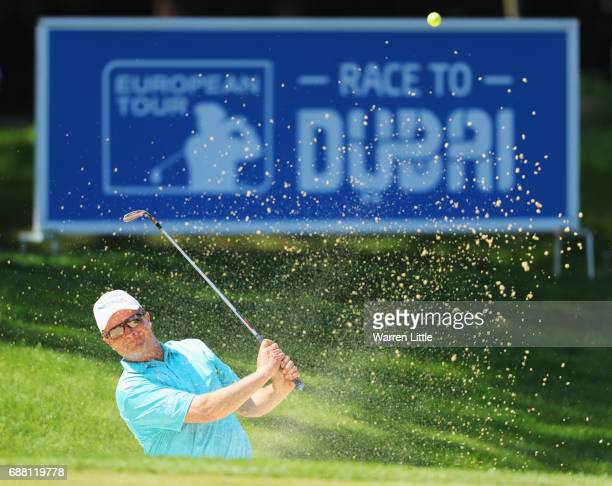 Greig Hutcheon of Scotland plays from a bunker on the 15th hole during day one of the BMW PGA Championship at Wentworth on May 25 2017 in Virginia...
