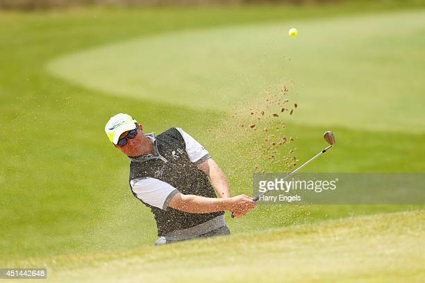 Greig Hutcheon of Scotland plays out of a bunker on day four of the 2014 Scottish Hydro Challenge hosted by Macdonald Hotels Resorts at Spey Valley...