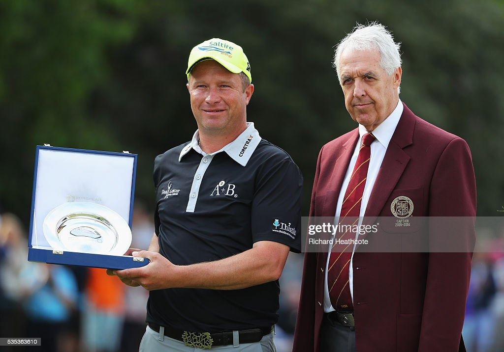 <a gi-track='captionPersonalityLinkClicked' href=/galleries/search?phrase=Greig+Hutcheon&family=editorial&specificpeople=2292138 ng-click='$event.stopPropagation()'>Greig Hutcheon</a> of Scotland poses with his award for the Leading PGA Professional and Nicky Lamb, Captain of the PGA during day four of the BMW PGA Championship at Wentworth on May 29, 2016 in Virginia Water, England.
