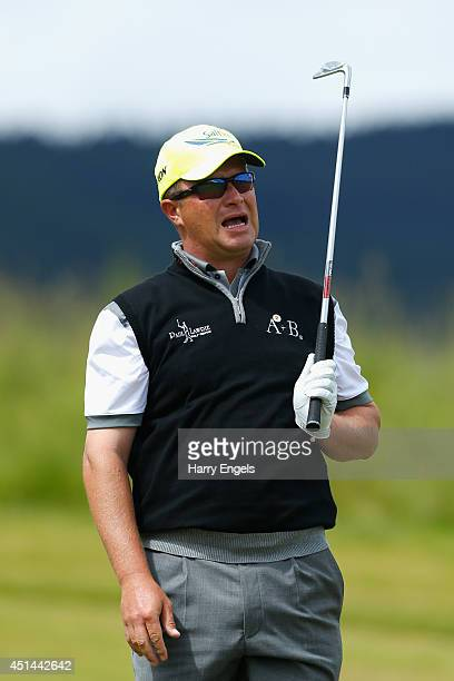 Greig Hutcheon of Scotland reacts after playing off the fairway at the third on day four of the 2014 Scottish Hydro Challenge hosted by Macdonald...