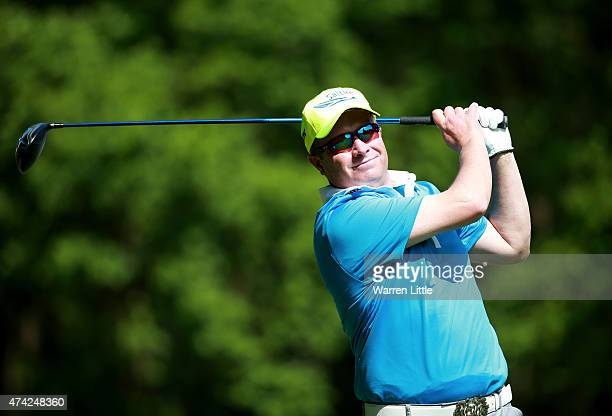 Greig Hutcheon of Scotland tees off on the 3rd hole during day 1 of the BMW PGA Championship at Wentworth on May 21 2015 in Virginia Water England