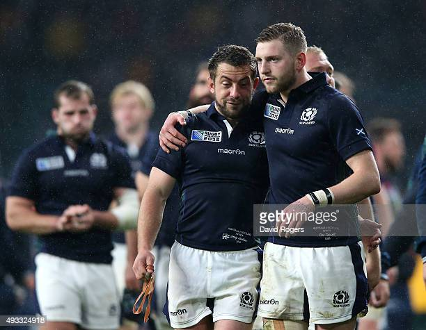 Greig Laidlaw and Finn Russell of Scotland look dejected after the 2015 Rugby World Cup Quarter Final match between Australia and Scotland at...