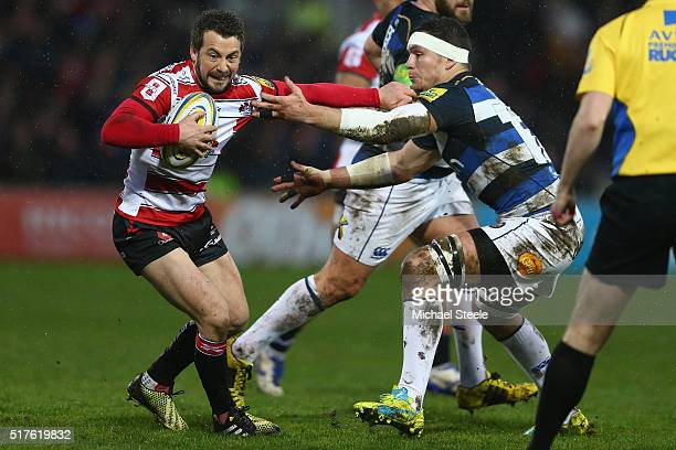 Greig Laidlaw of Gloucester is challenged by Francois Louw of Bath during the Aviva Premiership match between Gloucester and Bath at Kingsholm on...