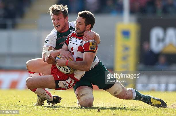 Greig Laidlaw of Gloucester is tackled by Brendon O'Conoor during the Aviva Premiership match between Leicester Tigers and Gloucester at Welford Road...