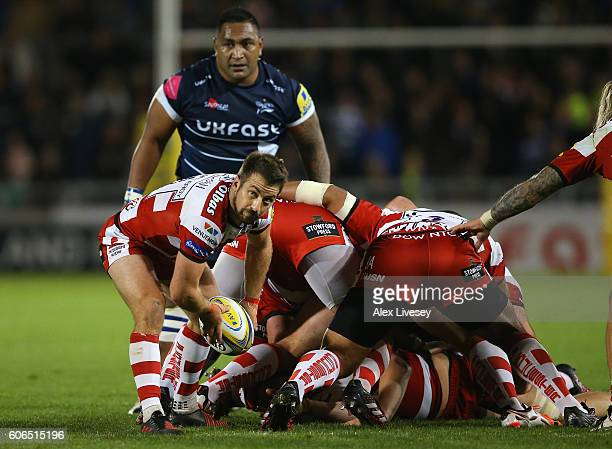 Greig Laidlaw of Gloucester Rugby passes the ball out from a scrum during the Aviva Premiership match between Sale Sharks and Gloucester Rugby at AJ...