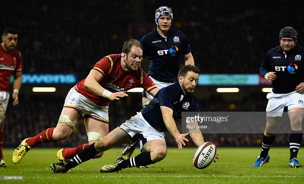 <a gi-track='captionPersonalityLinkClicked' href=/galleries/search?phrase=Greig+Laidlaw&family=editorial&specificpeople=5072404 ng-click='$event.stopPropagation()'>Greig Laidlaw</a> of Scotland carries the ball over his own tryline under pressure from Alun Wyn Jones of Wales during the RBS Six Nations match between Wales and Scotland at the Principality Stadium on February 13, 2016 in Cardiff, Wales.
