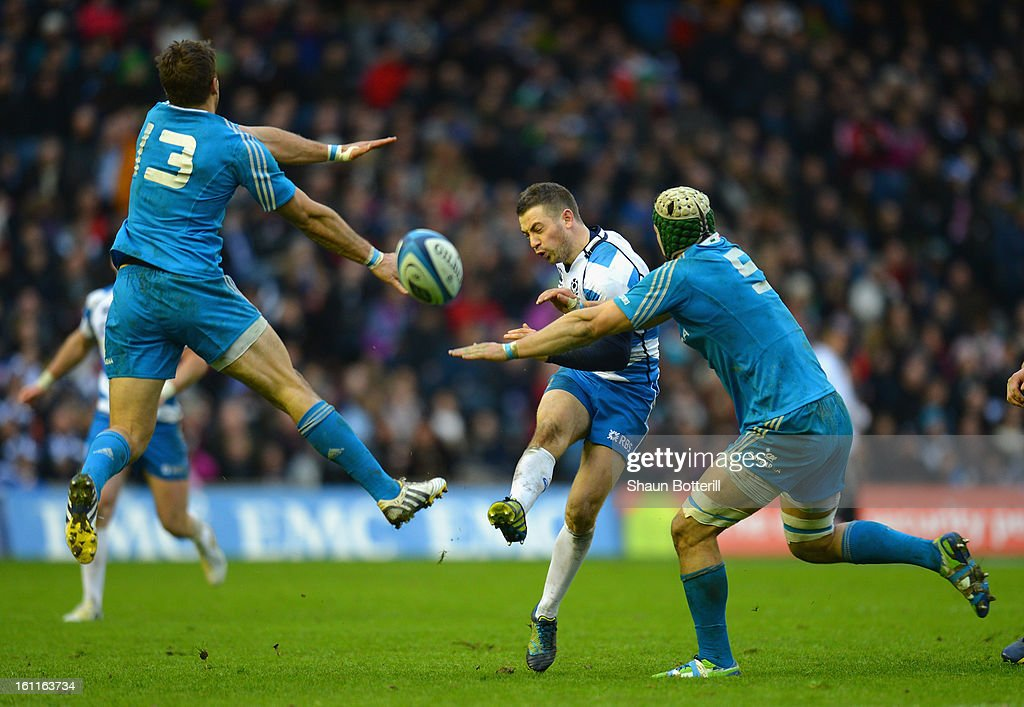 <a gi-track='captionPersonalityLinkClicked' href=/galleries/search?phrase=Greig+Laidlaw&family=editorial&specificpeople=5072404 ng-click='$event.stopPropagation()'>Greig Laidlaw</a> of Scotland kicks the ball between Tommaso Benvenuti and Francesco Minto of Italy during the RBS Six Nations match between Scotland and Italy at Murrayfield Stadium on February 9, 2013 in Edinburgh, Scotland.