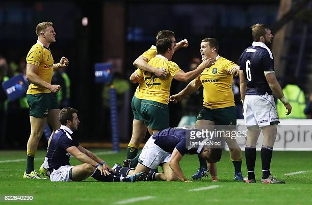 Greig Laidlaw of Scotland looks on as Australian players celebrate at full time during the Scotland v Australia Autumn Test Match at Murrayfield...