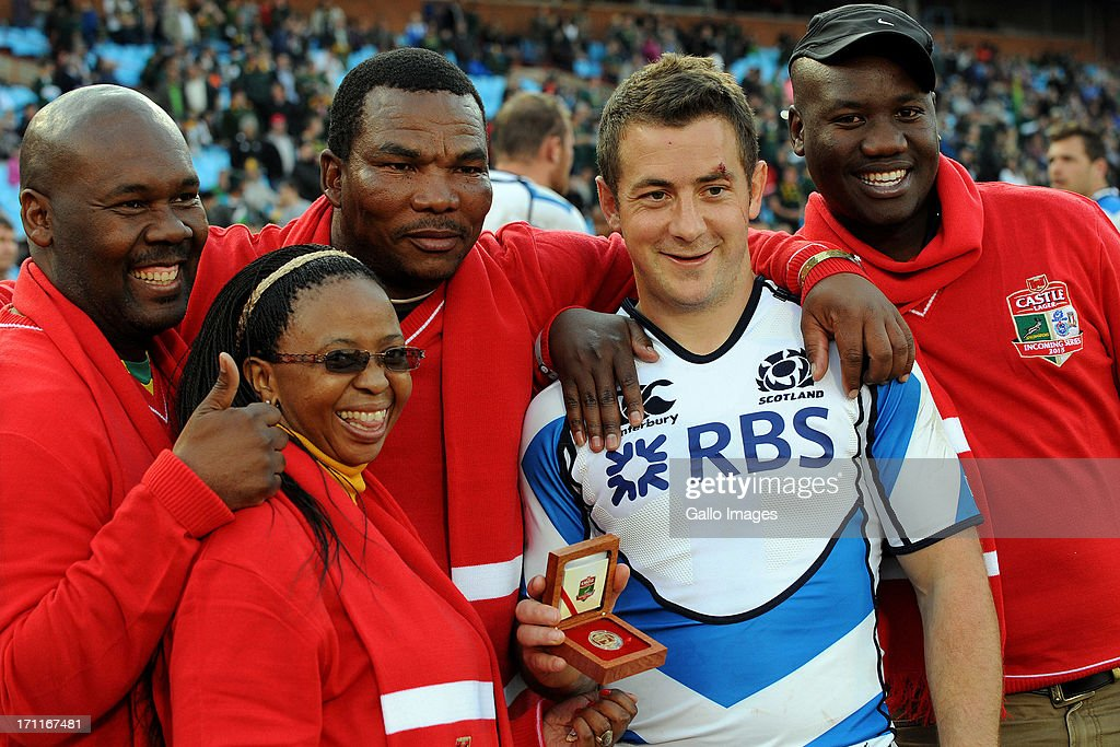 <a gi-track='captionPersonalityLinkClicked' href=/galleries/search?phrase=Greig+Laidlaw&family=editorial&specificpeople=5072404 ng-click='$event.stopPropagation()'>Greig Laidlaw</a> of Scotland poses with fans during the Castle Larger Incoming Tour match between Italy and Scotland at Loftus Versfeld on June 22, 2013 in Pretoria, South Africa.