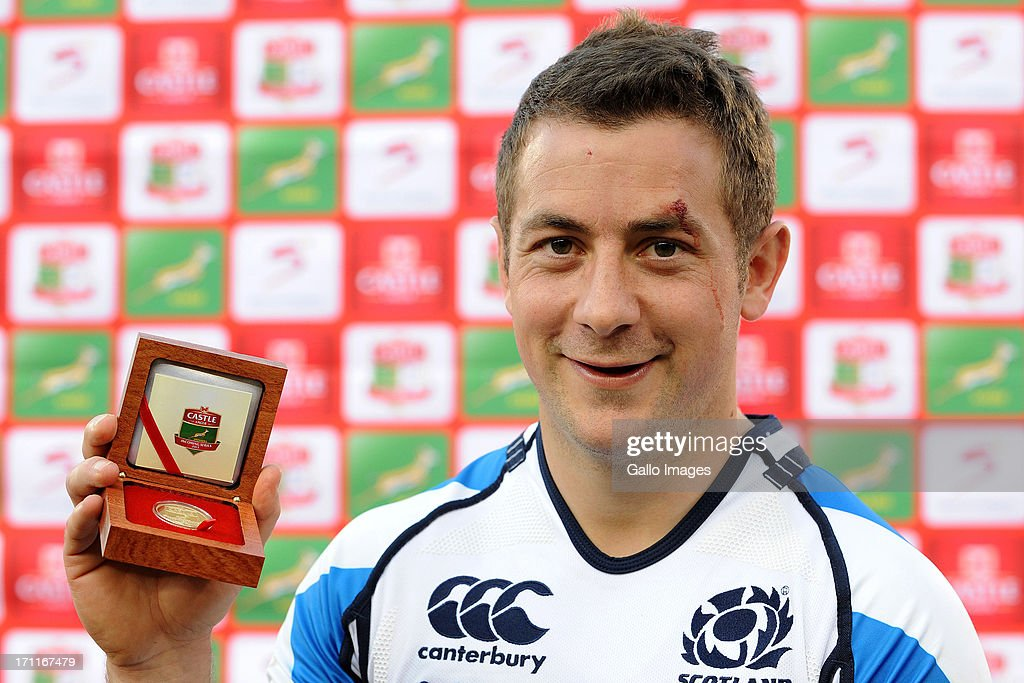 <a gi-track='captionPersonalityLinkClicked' href=/galleries/search?phrase=Greig+Laidlaw&family=editorial&specificpeople=5072404 ng-click='$event.stopPropagation()'>Greig Laidlaw</a> of Scotland poses with his medal during the Castle Larger Incoming Tour match between Italy and Scotland at Loftus Versfeld on June 22, 2013 in Pretoria, South Africa.
