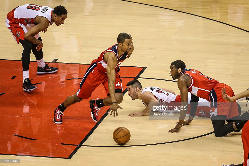 TORONTO, ON- APRIL 18 - <a gi-track='captionPersonalityLinkClicked' href=/galleries/search?phrase=Greivis+Vasquez&family=editorial&specificpeople=4066977 ng-click='$event.stopPropagation()'>Greivis Vasquez</a> (21) and DeMar DeRozan (10) of the Toronto Raptors loose possession of the ball to <a gi-track='captionPersonalityLinkClicked' href=/galleries/search?phrase=Ramon+Sessions&family=editorial&specificpeople=805440 ng-click='$event.stopPropagation()'>Ramon Sessions</a> (7) of the Washington Wizards late in the 2nd quarter during the game between the Toronto Raptors and the Washington Wizards at the Air Canada Centre April 18, 2015