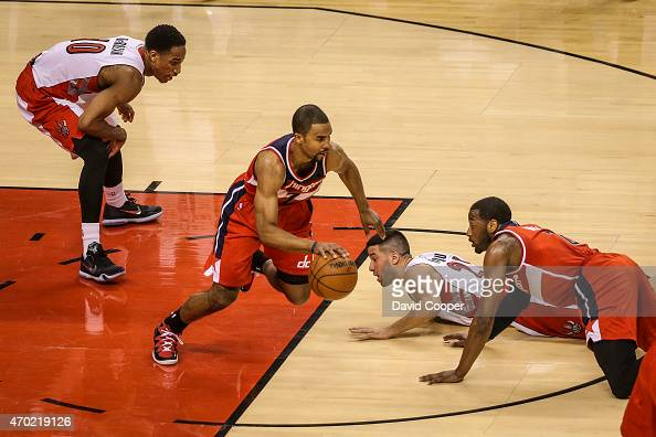 TORONTO ON APRIL 18 Greivis Vasquez and DeMar DeRozan of the Toronto Raptors loose possession of the ball to Ramon Sessions of the Washington Wizards...