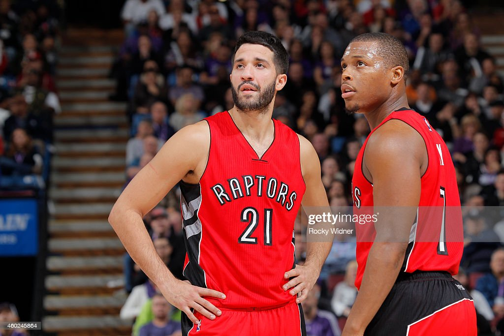 Greivis Vasquez and Kyle Lowry of the Toronto Raptors look on during the game against the Sacramento Kings on December 2 2014 at Sleep Train Arena in...