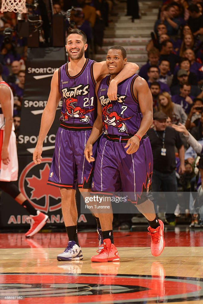 <a gi-track='captionPersonalityLinkClicked' href=/galleries/search?phrase=Greivis+Vasquez&family=editorial&specificpeople=4066977 ng-click='$event.stopPropagation()'>Greivis Vasquez</a> #21 and <a gi-track='captionPersonalityLinkClicked' href=/galleries/search?phrase=Kyle+Lowry&family=editorial&specificpeople=714625 ng-click='$event.stopPropagation()'>Kyle Lowry</a> #7 of the Toronto Raptors smile during the game against the Washington Wizards on November 7, 2014 at the Air Canada Centre in Toronto, Ontario, Canada.