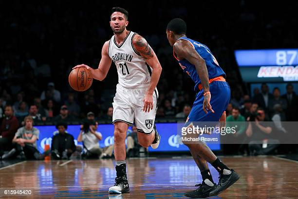 Greivis Vasquez of the Brooklyn Nets dribbles up the court against Brandon Jennings of the New York Knicks during the first half of their preseason...