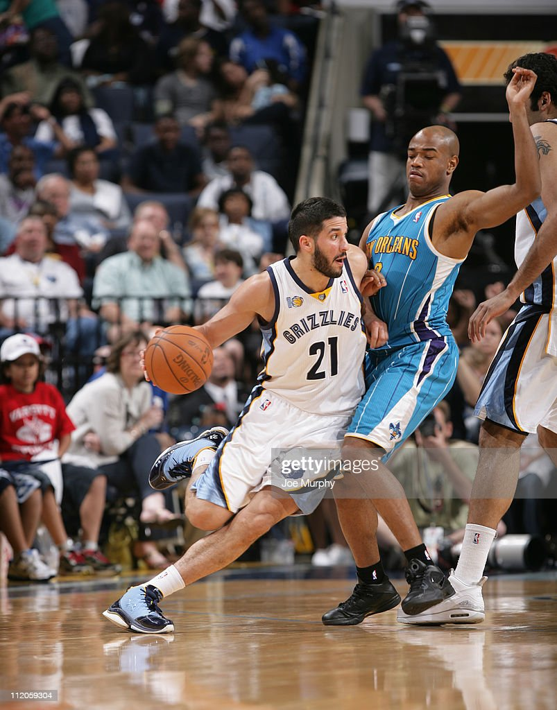 <a gi-track='captionPersonalityLinkClicked' href=/galleries/search?phrase=Greivis+Vasquez&family=editorial&specificpeople=4066977 ng-click='$event.stopPropagation()'>Greivis Vasquez</a> #21 of the Memphis Grizzlies drives to the basket against <a gi-track='captionPersonalityLinkClicked' href=/galleries/search?phrase=Jarrett+Jack&family=editorial&specificpeople=208109 ng-click='$event.stopPropagation()'>Jarrett Jack</a> #2 of the New Orleans Hornets during the game on April 10, 2011 at FedExForum in Memphis, Tennessee.