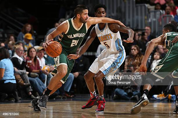 Greivis Vasquez of the Milwaukee Bucks controls the ball against Will Barton of the Denver Nuggets at Pepsi Center on November 11 2015 in Denver...