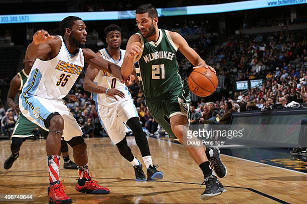 Greivis Vasquez of the Milwaukee Bucks drives with the ball against Kenneth Faried of the Denver Nuggets at Pepsi Center on November 11 2015 in...