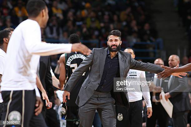 Greivis Vasquez of the Milwaukee Bucks shakes teammates hands on the bench during the game against the Los Angeles Lakers on February 22 2016 at the...