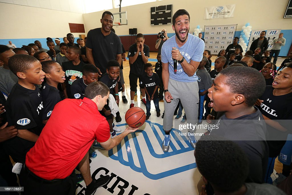 Greivis Vasquez #21 of the New Orleans Hornets and NBA legend Buck Williams instruct children during an NBA/WNBA Fit Court Dedication and Clinic at the FBR branch of the Boys and Girls Clubs of Greater Washington on May 19, 2013 in Washington, DC.