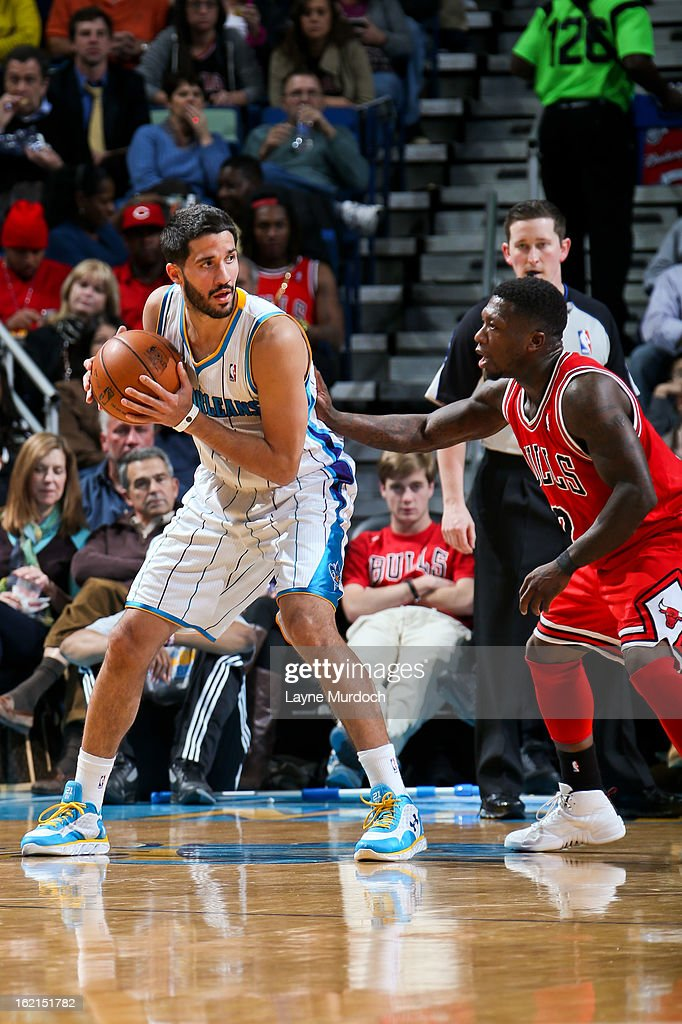 Greivis Vasquez #21 of the New Orleans Hornets controls the ball against Nate Robinson #2 of the Chicago Bulls on February 19, 2013 at the New Orleans Arena in New Orleans, Louisiana.