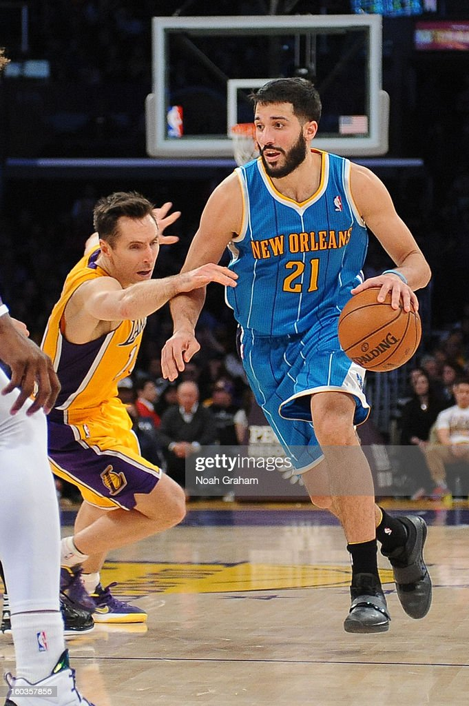 Greivis Vasquez #21 of the New Orleans Hornets dribbles against Steve Nash #10 of the Los Angeles Lakers at Staples Center on January 29, 2013 in Los Angeles, California.