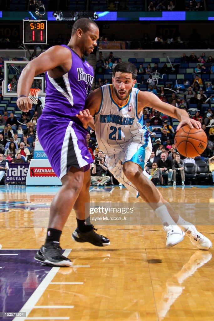Greivis Vasquez #21 of the New Orleans Hornets drives against Chuck Hayes #42 of the Sacramento Kings on February 24, 2013 at the New Orleans Arena in New Orleans, Louisiana.