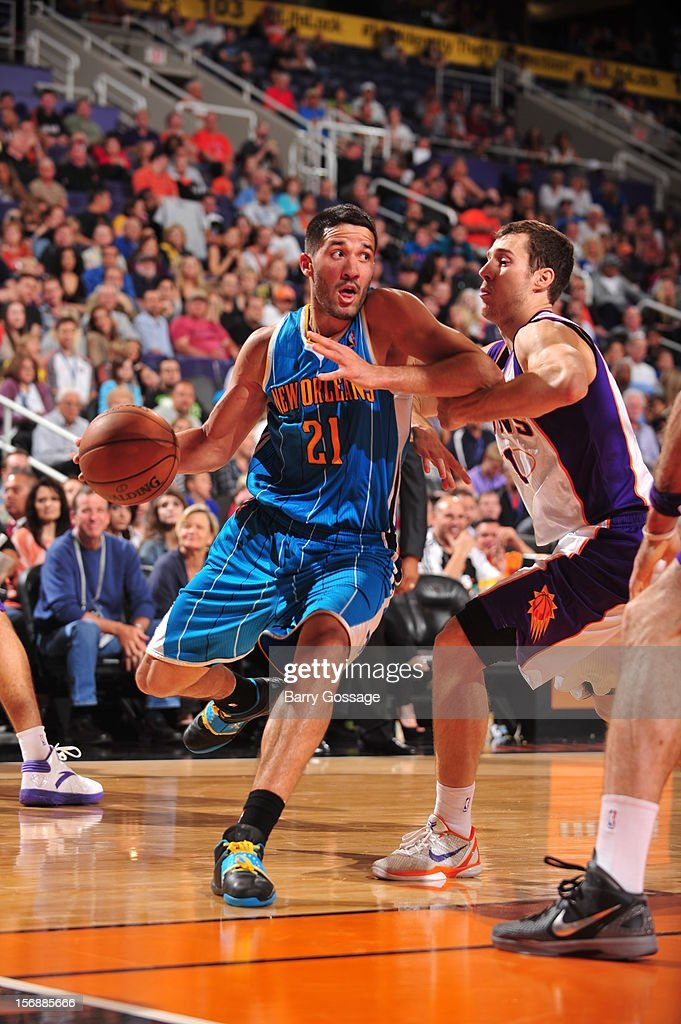 <a gi-track='captionPersonalityLinkClicked' href=/galleries/search?phrase=Greivis+Vasquez&family=editorial&specificpeople=4066977 ng-click='$event.stopPropagation()'>Greivis Vasquez</a> #21 of the New Orleans Hornets drives against <a gi-track='captionPersonalityLinkClicked' href=/galleries/search?phrase=Goran+Dragic&family=editorial&specificpeople=4452965 ng-click='$event.stopPropagation()'>Goran Dragic</a> #1 of the Phoenix Suns on November 23, 2012 at U.S. Airways Center in Phoenix, Arizona.