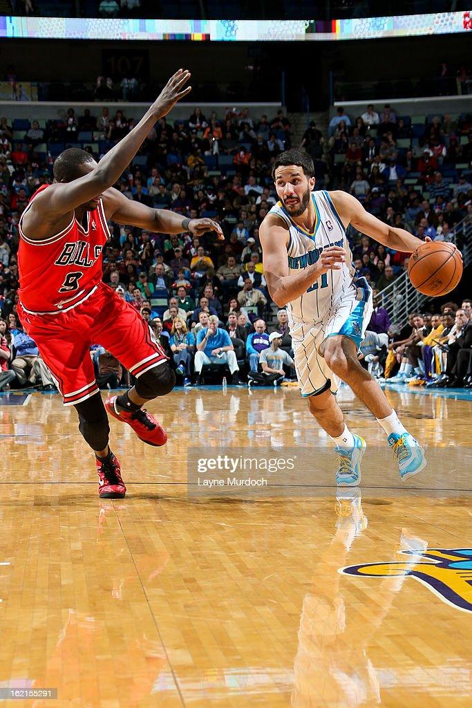 Greivis Vasquez #21 of the New Orleans Hornets drives against Luol Deng #9 of the Chicago Bulls on February 19, 2013 at the New Orleans Arena in New Orleans, Louisiana.