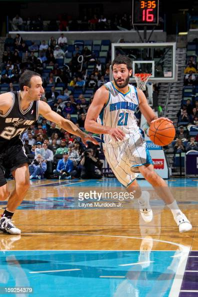 Greivis Vasquez of the New Orleans Hornets drives against Manu Ginobili of the San Antonio Spurs on January 7 2013 at the New Orleans Arena in New...