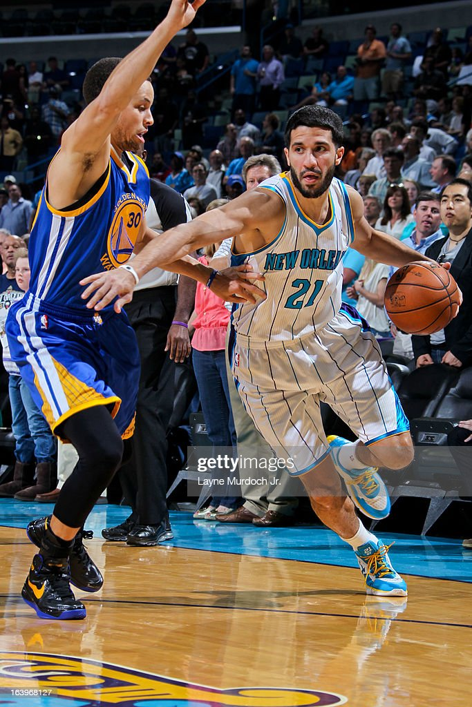 Greivis Vasquez #21 of the New Orleans Hornets drives against Stephen Curry #30 of the Golden State Warriors on March 18, 2013 at the New Orleans Arena in New Orleans, Louisiana.