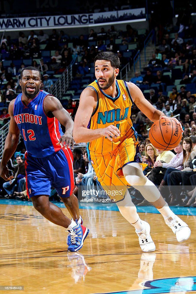 Greivis Vasquez #21 of the New Orleans Hornets drives ahead of Will Bynum #12 of the Detroit Pistons on March 1, 2013 at the New Orleans Arena in New Orleans, Louisiana.