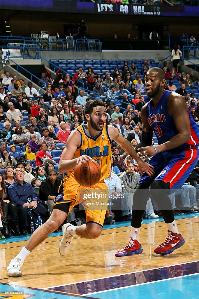 Greivis Vasquez #21 of the New Orleans Hornets drives along the baseline against Greg Monroe #10 of the Detroit Pistons on March 1, 2013 at the New Orleans Arena in New Orleans, Louisiana.