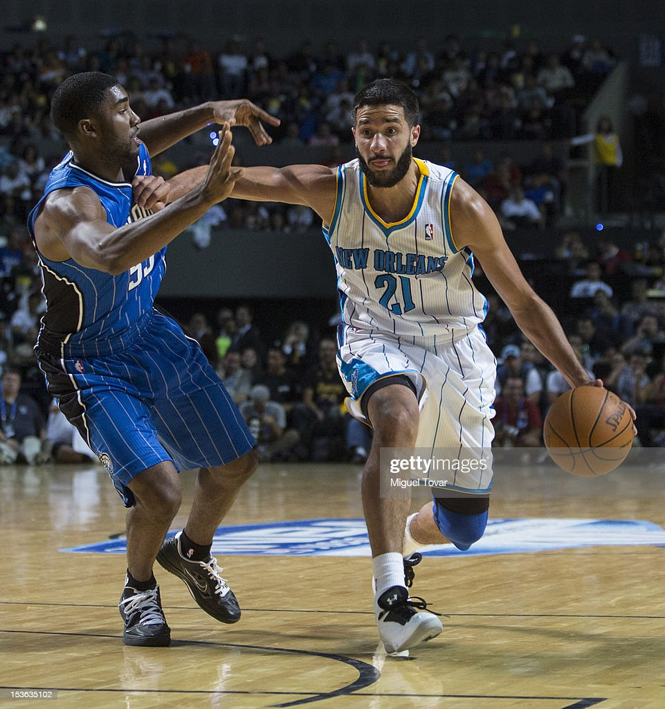 <a gi-track='captionPersonalityLinkClicked' href=/galleries/search?phrase=Greivis+Vasquez&family=editorial&specificpeople=4066977 ng-click='$event.stopPropagation()'>Greivis Vasquez</a> #21 of the New Orleans Hornets drives the ball as E´Twaun Moore #55 of the Orlando Magic defends during the game between the Orlando Magic and the New Orleans Hornets on October 7, 2012 at Mexico City Arena in Mexico City.