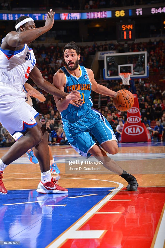 Greivis Vasquez #21 of the New Orleans Hornets drives to the basket against Kwame Brown #54 of the Philadelphia 76ers during the game at the Wells Fargo Center on January 15, 2013 in Philadelphia, Pennsylvania.