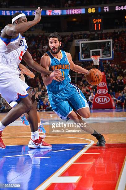 Greivis Vasquez of the New Orleans Hornets drives to the basket against Kwame Brown of the Philadelphia 76ers during the game at the Wells Fargo...
