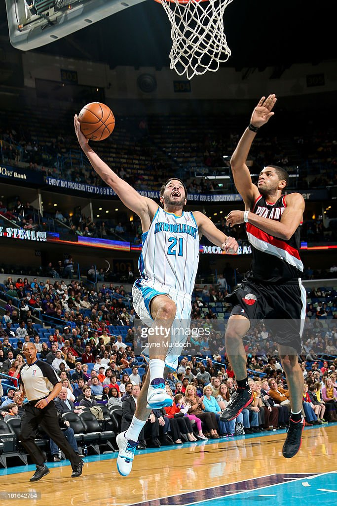 Greivis Vasquez #21 of the New Orleans Hornets drives to the basket against Nicolas Batum #88 of the Portland Trail Blazers on February 13, 2013 at the New Orleans Arena in New Orleans, Louisiana.