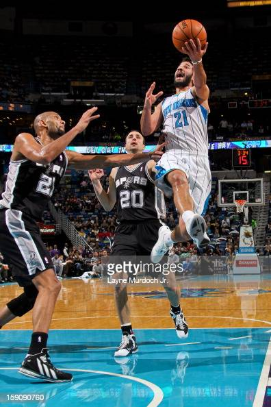 Greivis Vasquez of the New Orleans Hornets drives to the basket against Tim Duncan of the San Antonio Spurs on January 7 2013 at the New Orleans...