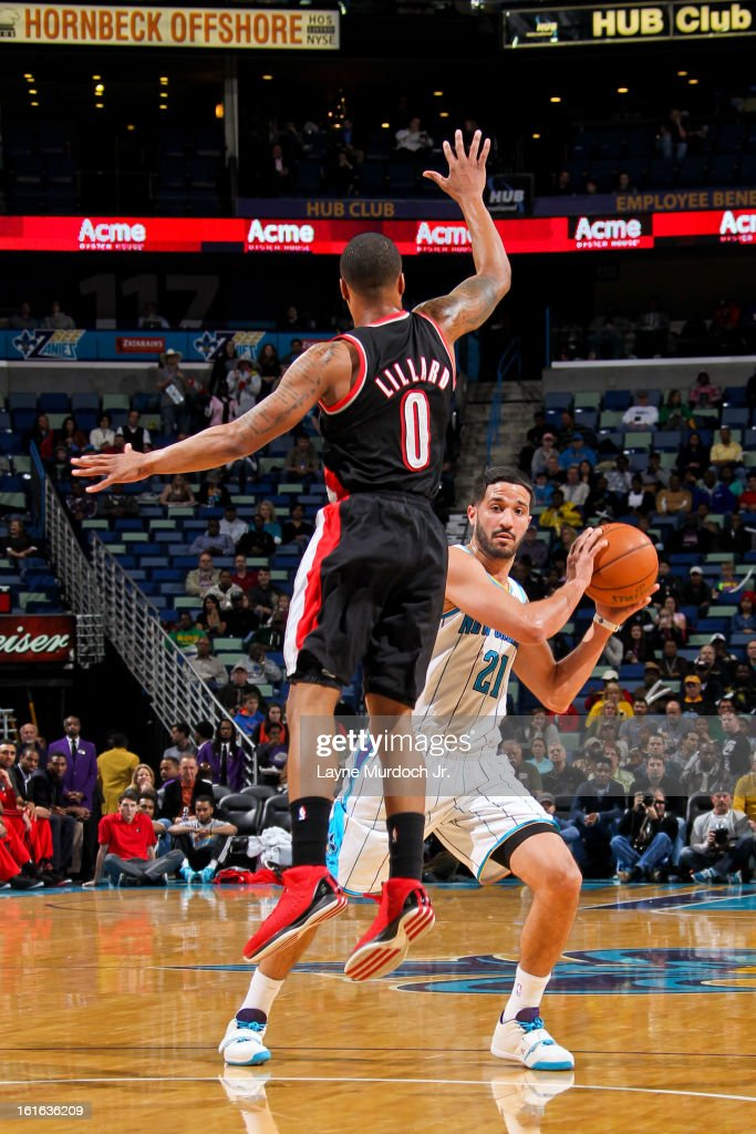 Greivis Vasquez #21 of the New Orleans Hornets fakes a shot attempt against Damian Lillard #0 of the Portland Trail Blazers on February 13, 2013 at the New Orleans Arena in New Orleans, Louisiana.