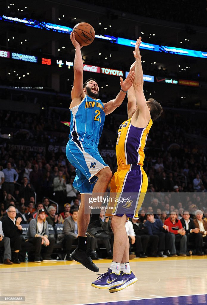 Greivis Vasquez #21 of the New Orleans Hornets goes up for a shot against Steve Nash #10 of the Los Angeles Lakers at Staples Center on January 29, 2013 in Los Angeles, California.