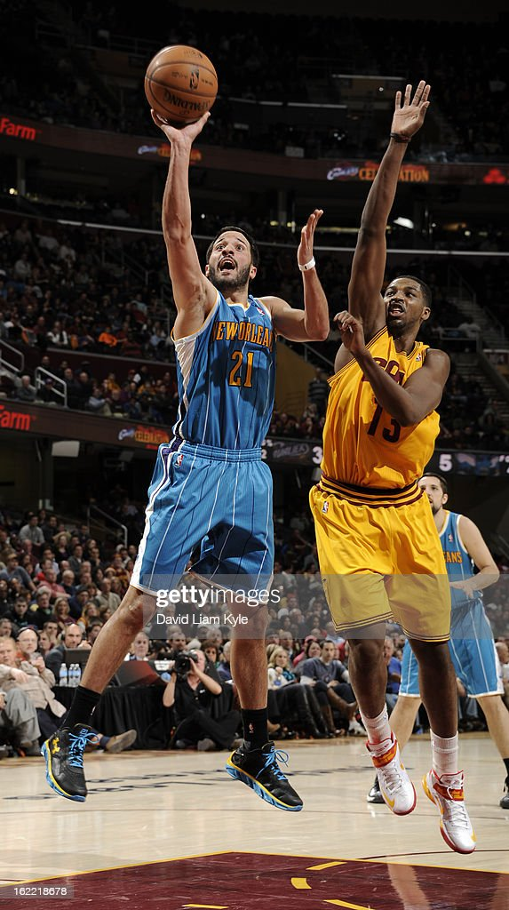 Greivis Vasquez #21 of the New Orleans Hornets goes up for the shot against <a gi-track='captionPersonalityLinkClicked' href=/galleries/search?phrase=Tristan+Thompson&family=editorial&specificpeople=5799092 ng-click='$event.stopPropagation()'>Tristan Thompson</a> #13 of the Cleveland Cavaliers at The Quicken Loans Arena on February 20, 2013 in Cleveland, Ohio.