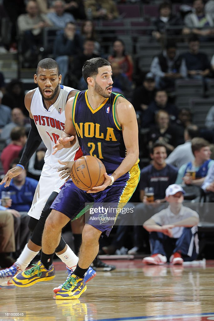 Greivis Vasquez #21 of the New Orleans Hornets handes the ball against Greg Monroe #10 of the Detroit Pistons on February 11, 2013 at The Palace of Auburn Hills in Auburn Hills, Michigan.