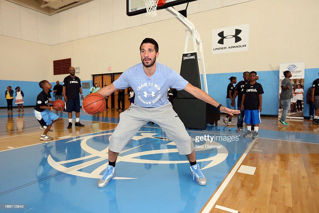 Greivis Vasquez #21 of the New Orleans Hornets instructs children during an NBA/WNBA Fit Court Dedication and Clinic at the FBR branch of the Boys and Girls Clubs of Greater Washington on May 19, 2013 in Washington, DC.